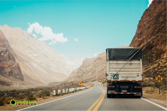 truck driving on mountain highway